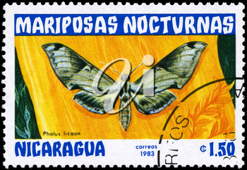 NICARAGUA - CIRCA 1983: A Stamp printed in NICARAGUA shows image of a Moth with the inscription Pholus licaon from the series Nocturnal Moths, circa 1983