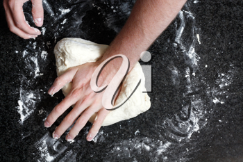 Royalty Free Photo of a Person Kneading Dough
