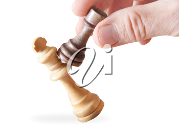 Royalty Free Photo of a Man Holding Chess Pieces
