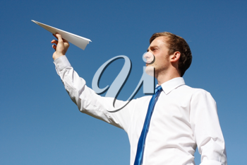 Royalty Free Photo of a Businessman Holding a Paper Airplane