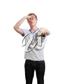 Royalty Free Photo of a Guy Holding Smelly Shoes