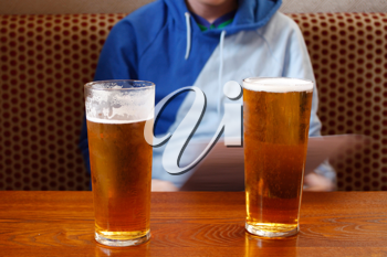 Royalty Free Photo of a Person With Two Beers