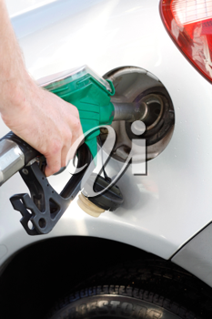 Royalty Free Photo of a Man Putting Gas Into His Car