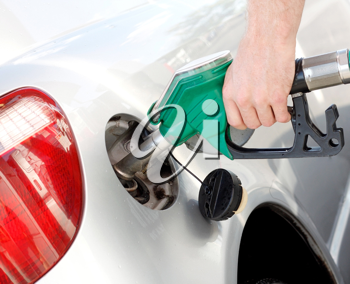 Royalty Free Photo of a Person Pumping Gas Into a Car