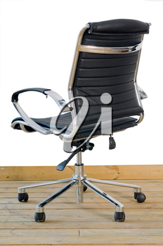 modern black leather office chair on wood floor over white background