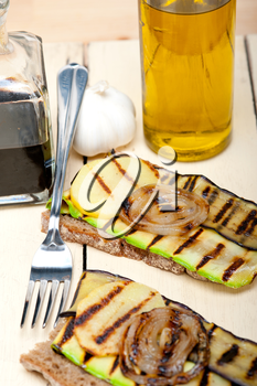 grilled vegetables on rustic  bread over wood table