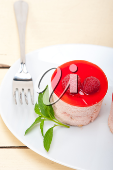 fresh raspberry cake mousse dessert round shape with mint leaves