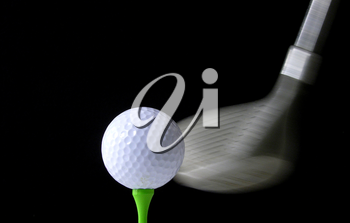Royalty Free Photo of a Driver Hitting a Golf Ball