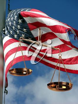 Royalty Free Photo of the Scales Of Justice And American Flag