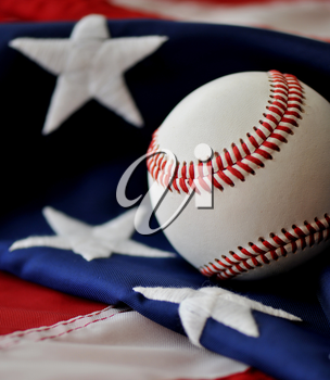 Royalty Free Photo of a Baseball on an American Flag
