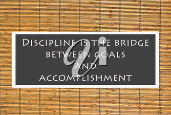 Royalty Free Photo of a Discipline Quote Over a Bamboo Background