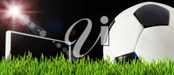 abstract football backgrounds. soccer ball on the green play field