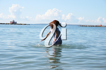 Royalty Free Photo of a Woman Walking in the Sea