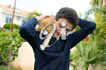 Royalty Free Photo of a Teenage Boy Holding a Cat