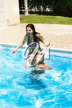 Royalty Free Photo of a Couple Swimming in a Pool