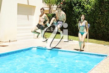 Royalty Free Photo of People Jumping into a Swimming Pool