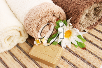 Royalty Free Photo of Flowers by Towels