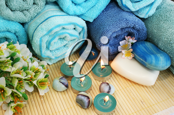 Royalty Free Photo of Candles by Towels