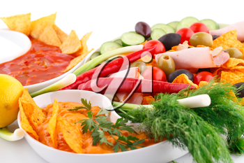 Nachos,  cheese and red sauce, vegetables image.