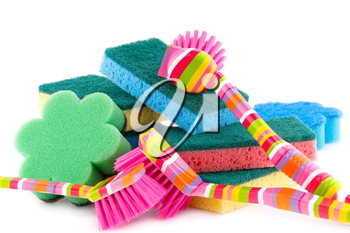 Colorful sponges and brushes isolated on white background.