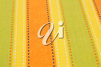 Striped tablecloth texture as a background, closeup picture.