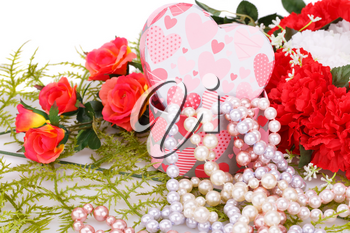 Flowers, colorful pearls necklaces and gift box on white background.