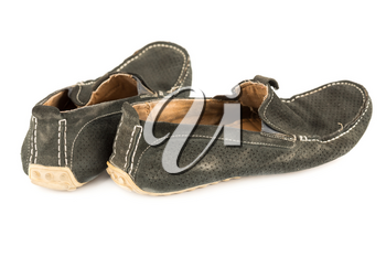 The pair of man old suede moccasins isolated on white background.