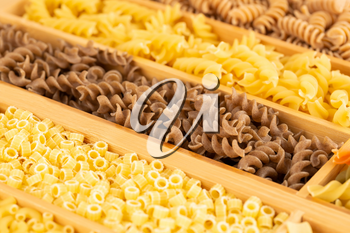 Various kind of Italian pasta in the wooden box.
