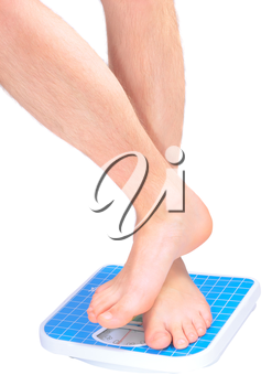 Man's legs , which weighed on floor scale. Isolated over white