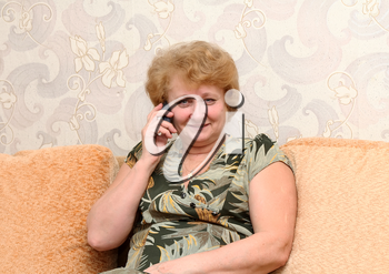 Royalty Free Clipart Image of a Senior Woman on a Phone