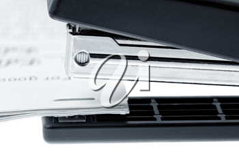 Stapler attach a documents. Isolated on a white background.
