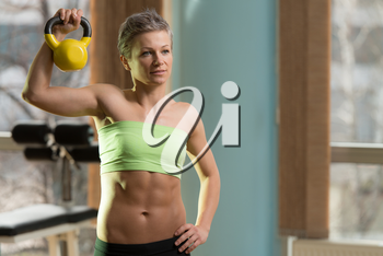 Beautiful Athletic Woman Workout With Kettle Bell