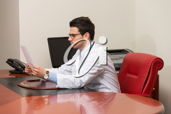 Doctor Writing A Letter - Notes Or Signing A Document Or Agreement