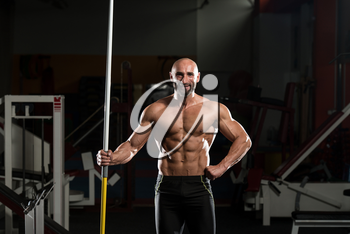 Portrait Of A Physically Fit Mature Male With Javelin