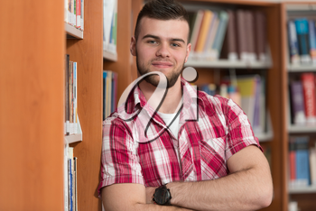 Portrait Of Clever Caucasian Student In College Library - Shallow Depth Of Field