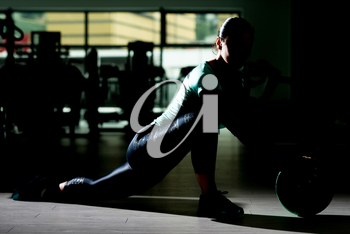 Siluet Attractive Woman Doing Stretching With Medicine Ball As Part Of Bodybuilding Training