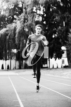 Young Athlete Man Running on Track In Park Run Athletics Race