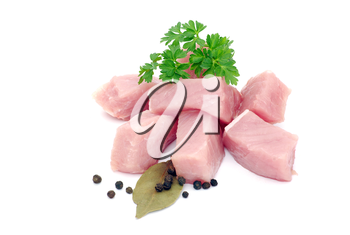 Pieces of crude meat with parsley