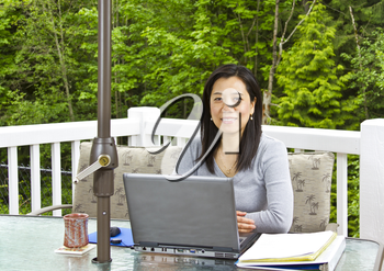 Asian lady working at home  on her outdoor patio