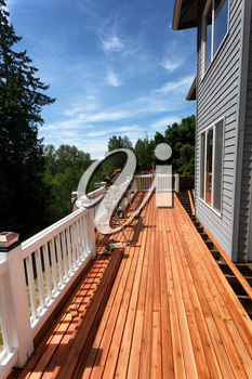 Side view of an outdoor wooden deck being completely remodeled during springtime season