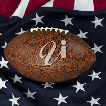 Leather football with American flag in background