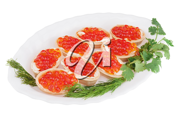 Tartlets with red caviar on plate isolated on white background. Closeup.