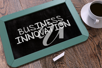 Business Innovation Concept Hand Drawn on Blue Chalkboard on Wooden Table. Business Background. Top View. 3d Render.