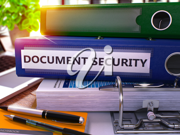 Blue Ring Binder with Inscription Document Security on Background of Working Table with Office Supplies and Laptop. Document Security Business Concept on Blurred Background. 3D Render.