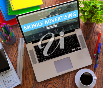 Mobile Advertising Concept. Modern Laptop and Different Office Supply on Wooden Desktop background. 3D Render.