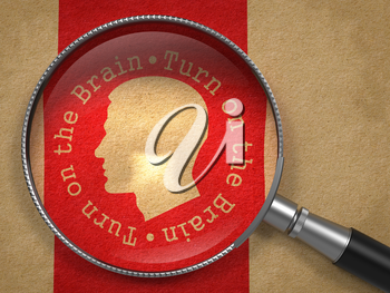 Magnifying Glass with Turn On the Brain Written Arround Human Head Icon on Old Paper with Red Vertical Line Background.