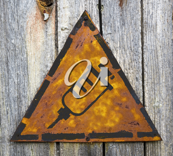 Royalty Free Photo of a Syringe on a Rustic Sign Hanging on Wood