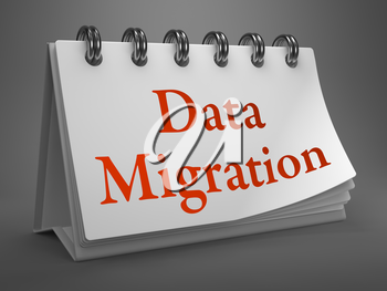 Data Migration - Red Words on White Desktop Calendar Isolated on Gray Background.