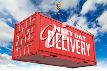 Next Day Delivery - Red Cargo Container hoisted with hook on Blue Sky Background.