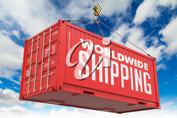 World Wide Shipping - Red Cargo Container hoisted with hook on Blue Sky Background.